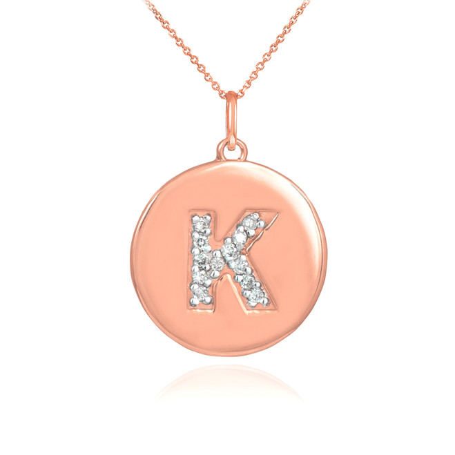 "Letter ""K"" disc pendant necklace with diamonds in 14k rose gold."