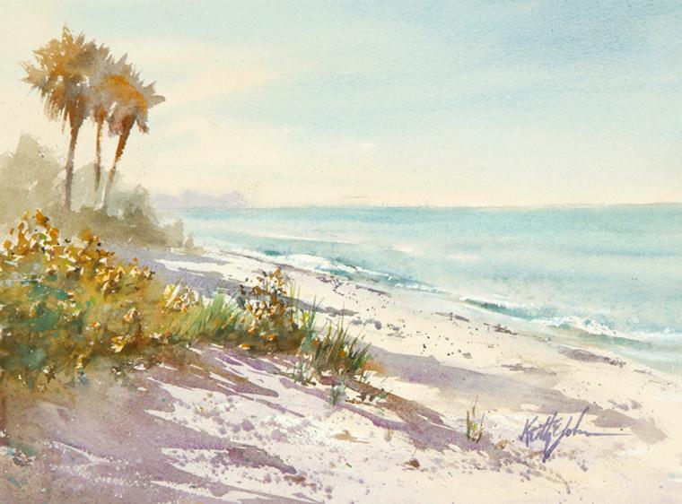 The fresh morning sun lights up the still empty beach.