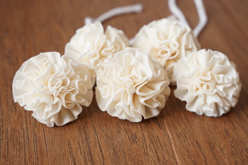 Carnation flowers with cotton wick, handcrafted from sola wood.