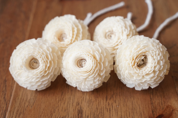 Zinnia flowers handcrafted from sola wood, with cotton wick.