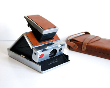 Pre-Owned  Polaroid  SX-70 silver and Brown leather  camera