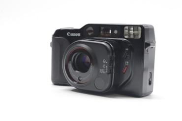 Pre-Owned Canon Sure Shot TELE 35mm Film Camera w/ Canon Lens 40/70mm 1:2.8/4.9 Camera (Black Color)