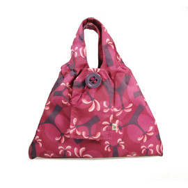 Small fabric Gift Bag in Raspberry.  Shown wrapping example gift.