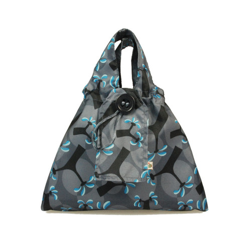 Small fabric Gift Bag in Ocean Blue.  Pictured wrapping example gift.