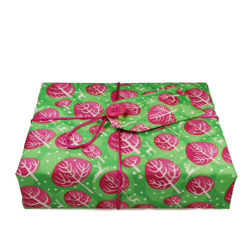 Medium Crackle fabric wrap in Neon Pink.  Shown wrapping a large hardback cookery book.