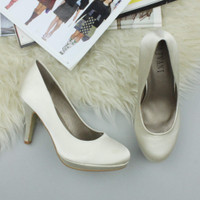 Closeup view of features of Ivory Satin High Heel Platform Court Shoes