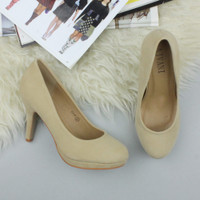 Closeup view of features of Nude Suede High Heel Platform Court Shoes