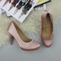 Closeup view of features of Champagne Pink Satin High Heel Platform Court Shoes