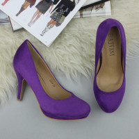 Closeup view of features of Purple Suede High Heel Platform Court Shoes