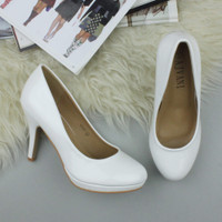 Closeup view of features of White Patent High Heel Platform Court Shoes