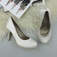 Closeup view of features of White Satin High Heel Platform Court Shoes