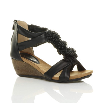 Front right side view of Black PU Mid Heel Wedge T-Bar Flower Sandals