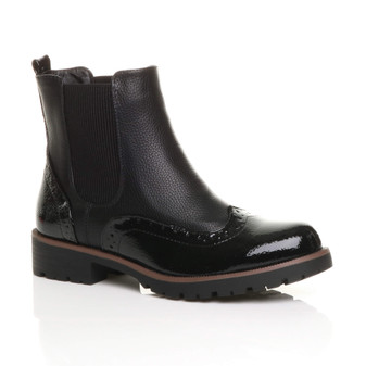 Front right side view of Black PU Low Block Heel Pull On Chunky Brogue Chelsea Ankle Boots
