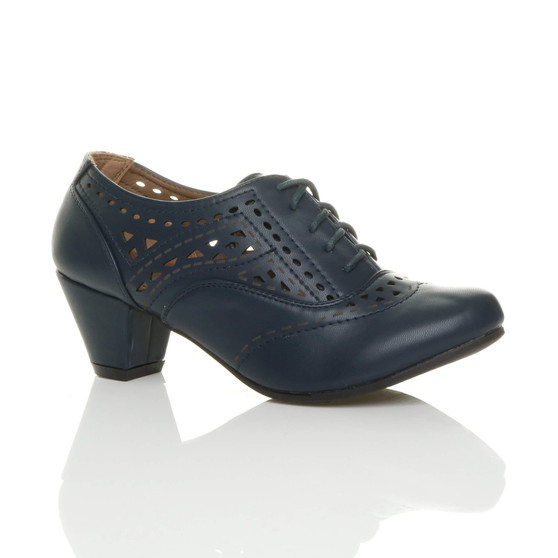 Front right side view of Navy PU Mid Heel Cut Out Brogue Shoe Boots