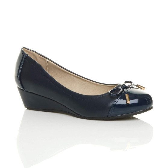 Front right side view of Navy PU Low Mid Wedge Bow Court Shoes