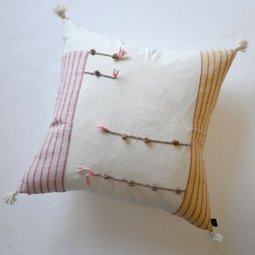 pastel pink and yellow throw pillow