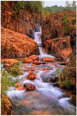 """Red Stone Falls"" -  fine art photo print of a waterfall at Mahabaleshwar by Swapnil Nevgi"
