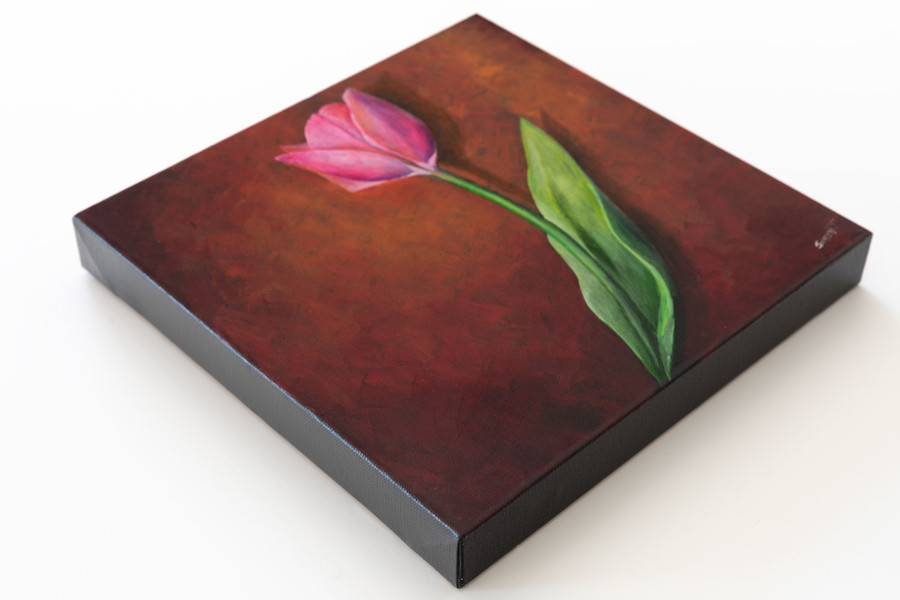 "Side view of ""Pink Tulip on Red"" painting"