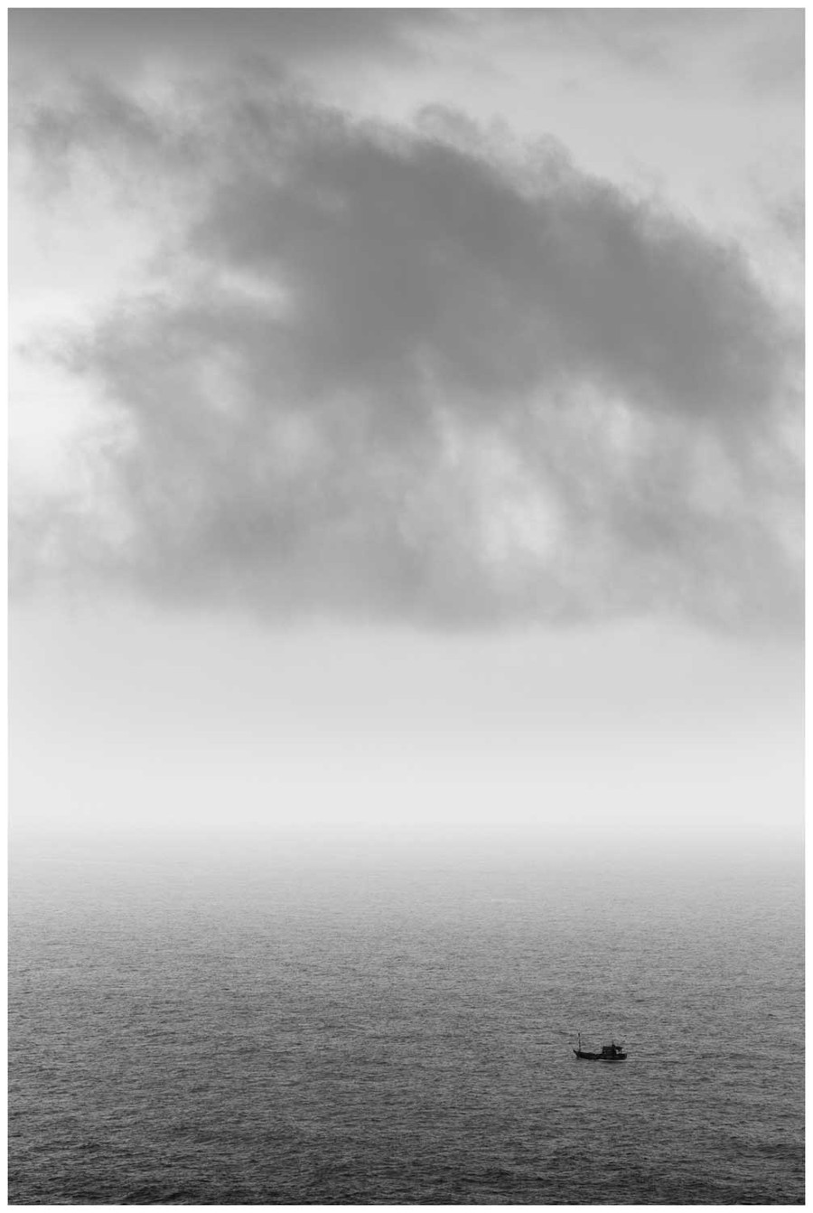 """Adventurous soul"" -  black and white fine art photo print of a lonely boat in the vast sea by Swapnil Nevgi"