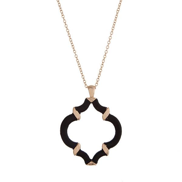 "29"" Gold tone necklace with a black thread wrapped quatrefoil pendant."