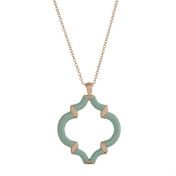 """29"""" Gold tone necklace with a mint green thread wrapped quatrefoil pendant."""