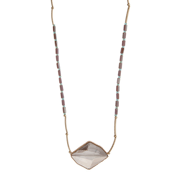 """Gold tone necklace displaying pale purple and turquoise beads with a gray stone pendant. Approximately 32"""" in length."""