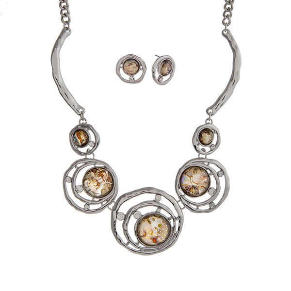 """Silver tone necklace set displaying layered rings with abalone cabochons and rhinestone accents. Approximately 17"""" in length."""
