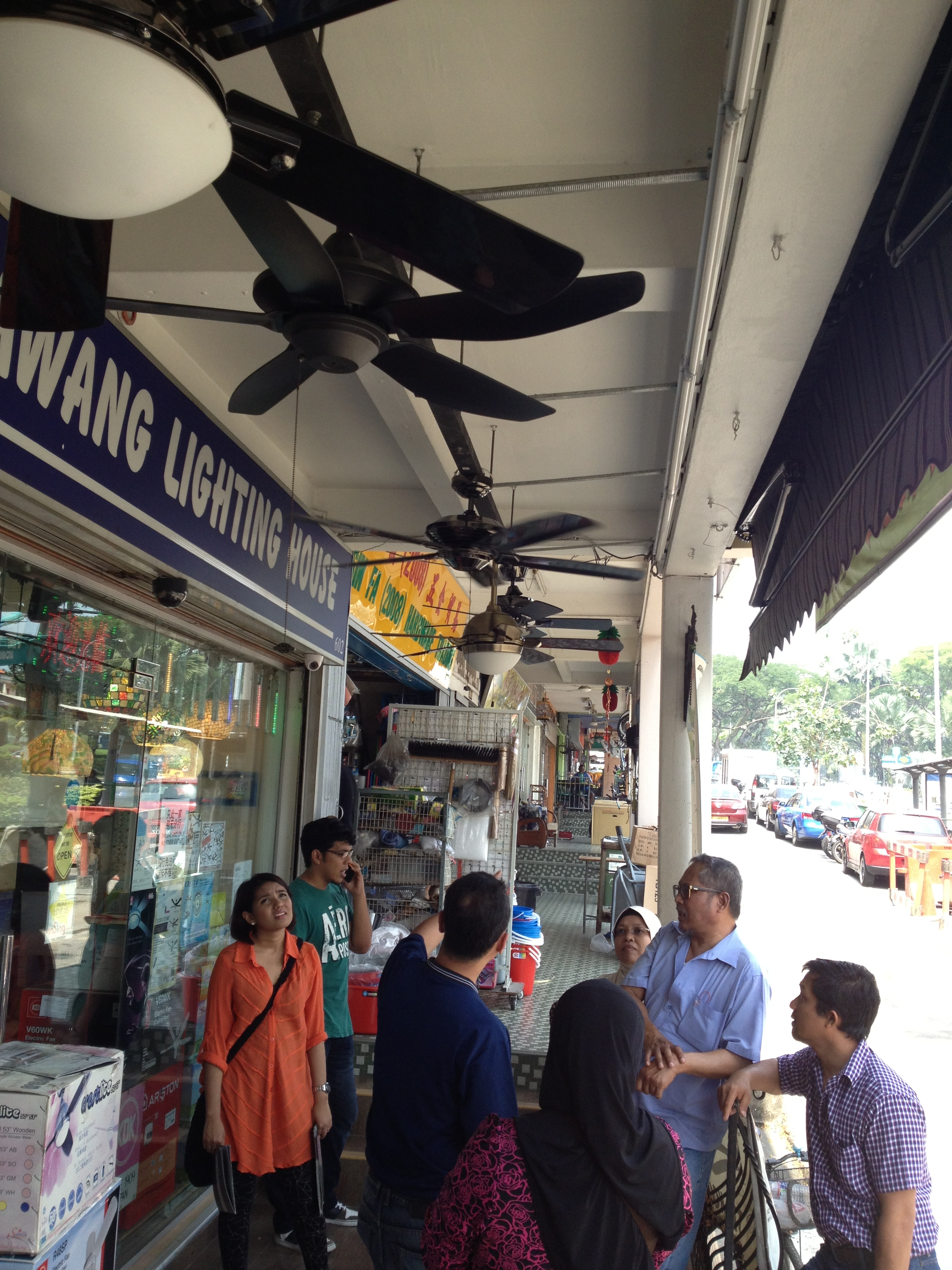 Checking our ceiling fans at Sembawang Lighting House.jpg