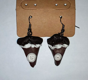 Chocolate Pie Earrings are handmade out of polymer clay. Each earring has whipped cream on top.