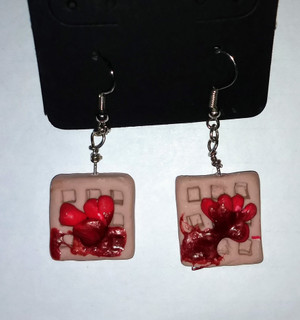 Waffles with Strawberry Syrup and Sliced Fruit Earrings are made from polymer clay. Each pair is hand-sculpted.