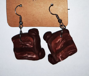 Example of Chocolate Marble Cake Slice Earrings made with polymer clay.
