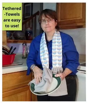Tethered-Towels are Hand-towels sewn to the ends of a strip of fabric. The fabric is stitched together. Place the long piece of fabric over shoulders and use towels.