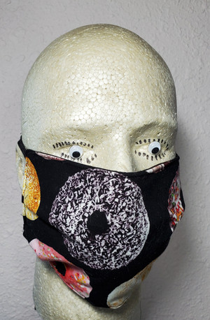 Doughnut Face Mask with Black Background. Different types of doughnuts are on each mask.