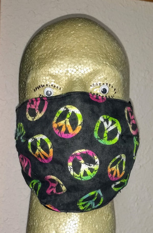 Tie-dye Peace Symbol Face Mask - view of mask front. Peace masks are randomly on this mask with a black background.