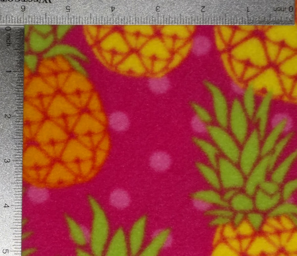 Yellow and Orange Pineapples on Pink Background