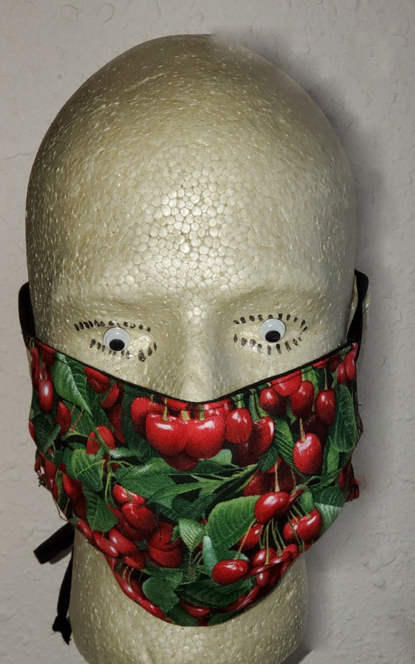 Cherry Print Face Mask - the mask surface has a beautiful cherry print fabric.
