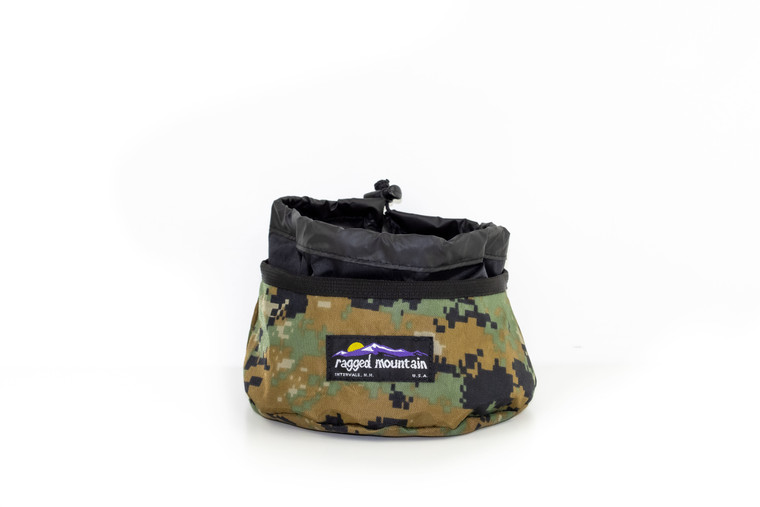 Camouflage foldable dog bowl with cinch lid.