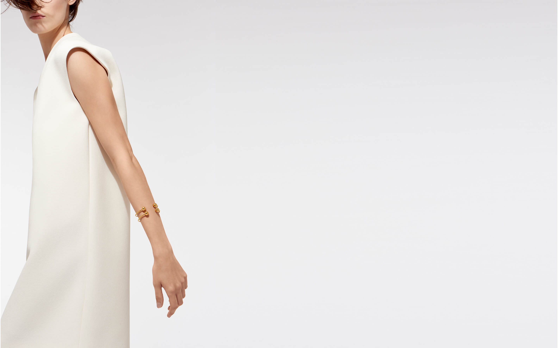 22 karat gold wrist cuff in cosmic design on model in profile