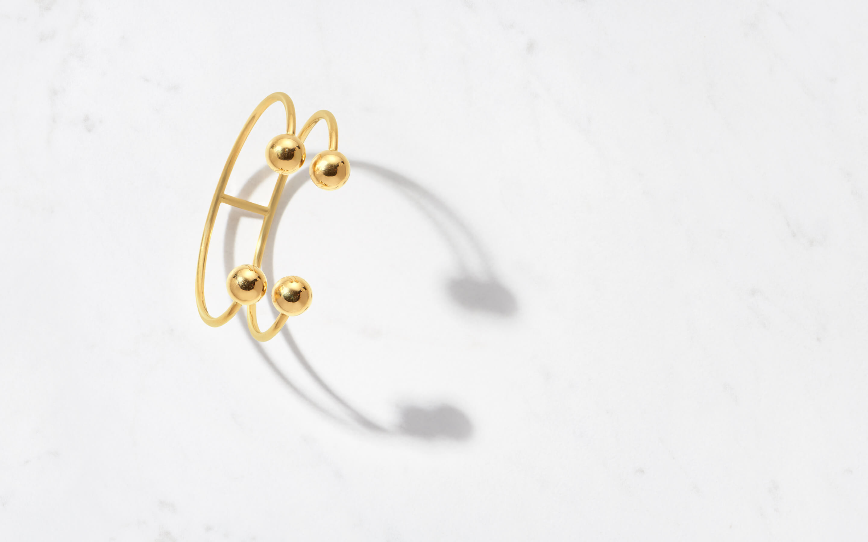 contemporary 22 karat gold cuff in orbital pattern with spheres