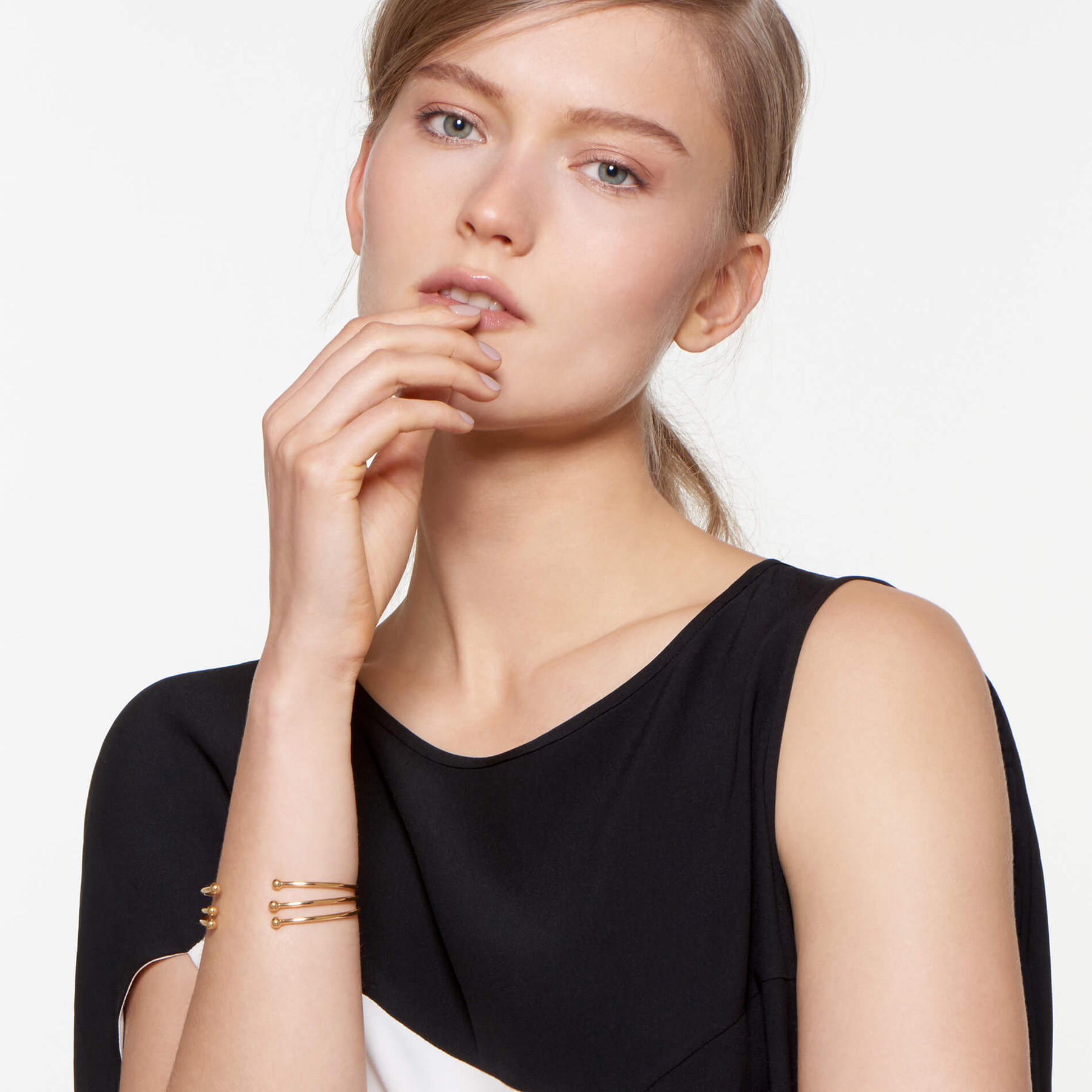 gorgeous blonde modeling 22 karat gold cuff with small globes