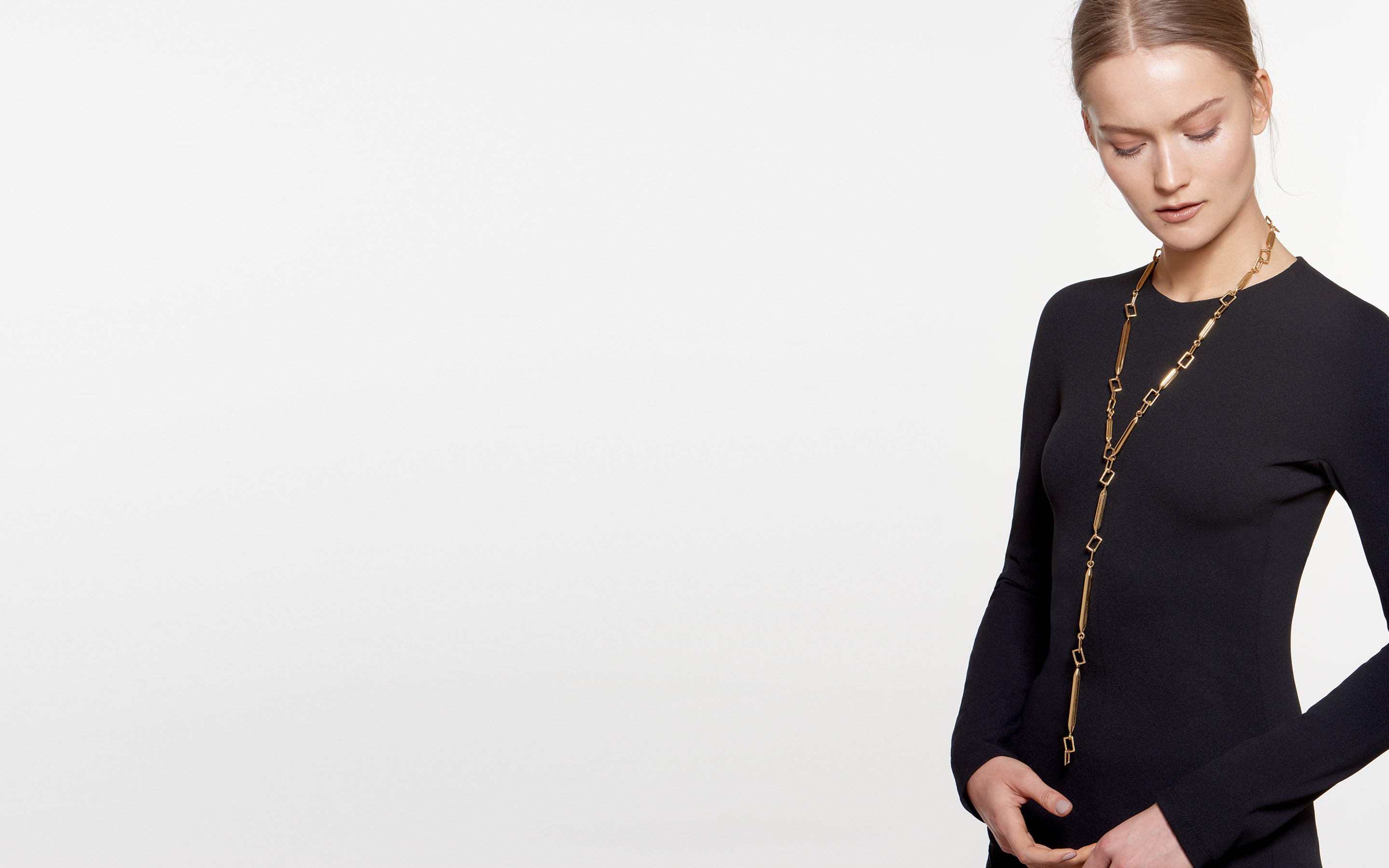 pensive model showcasing 22 karat gold necklace fashioned of geometric links