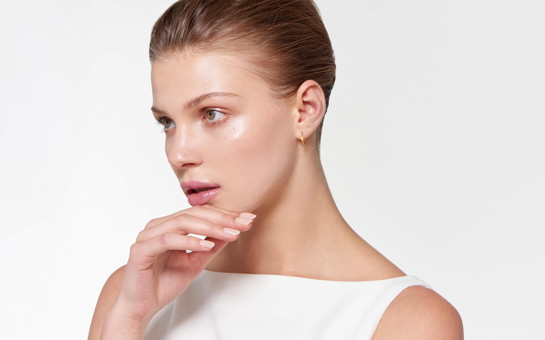 satin gold 22 karat hoop earrings on alluring model