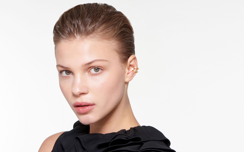 22 karat gold ear cuffs in polished finish adorning elegant female model
