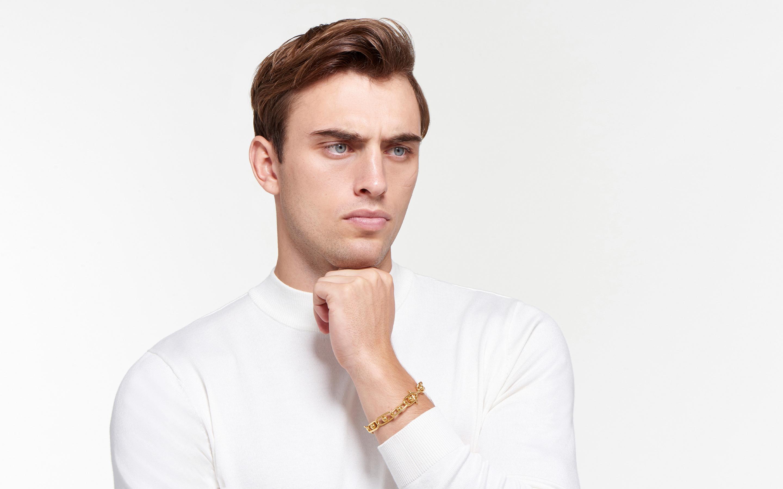 Male model wearing 22 karat gold bracelet