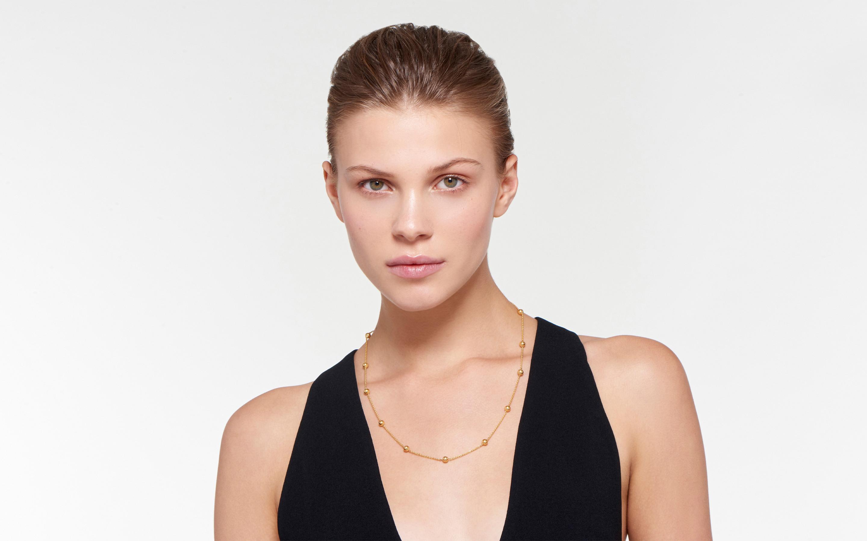 Woman model wearing 22 karat gold necklace