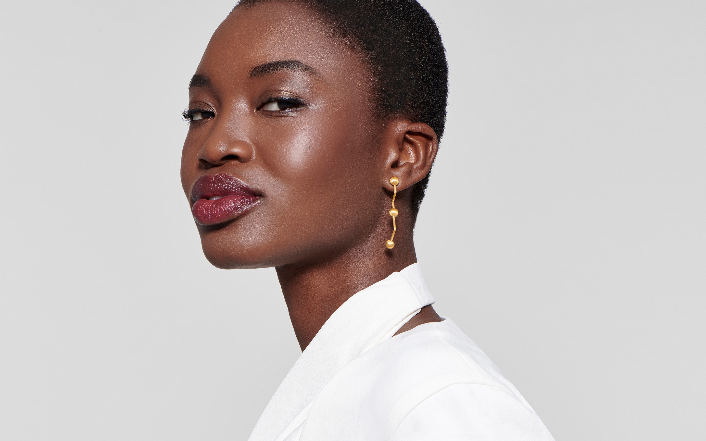 Woman model wearing 22 karat gold earring