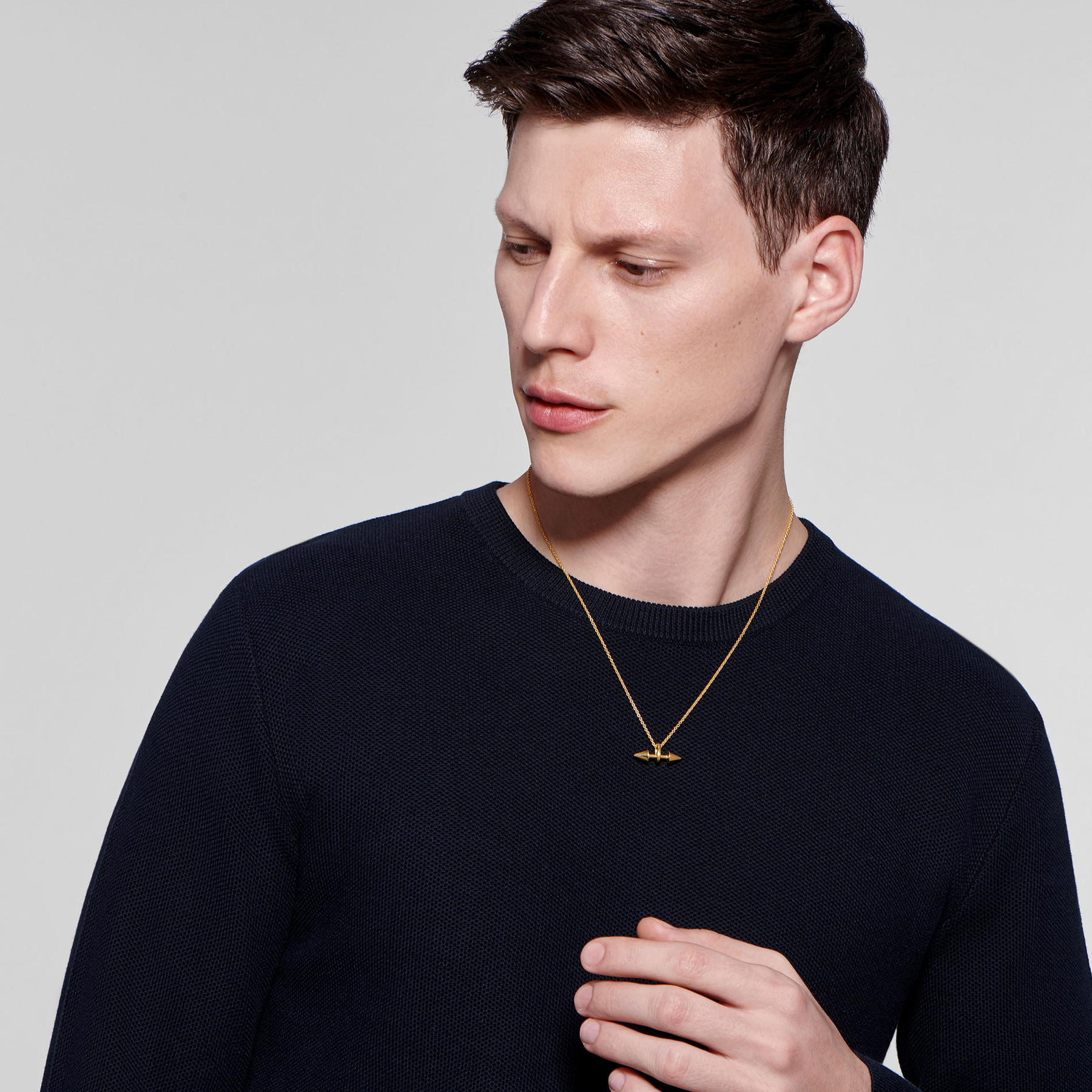 22 karat gold necklace with double-ended cones on attractive male model