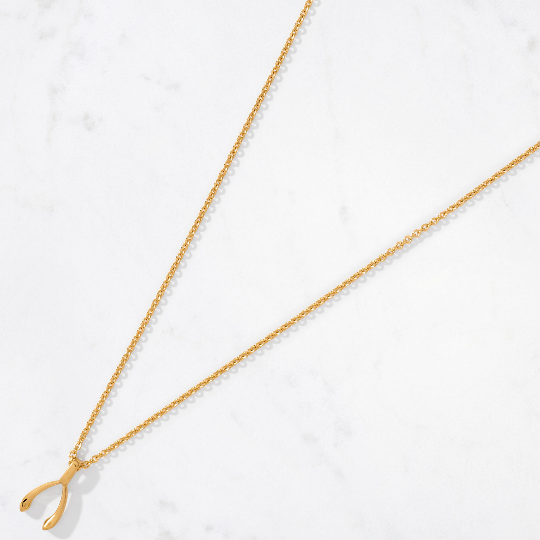 A little bit of luck goes a long way. Our Small Wishbone Pendant handcrafted in 22 karat polished gold with a gold weight of approximately 6 grams is a delicate reminder that good things sometimes come in small packages.