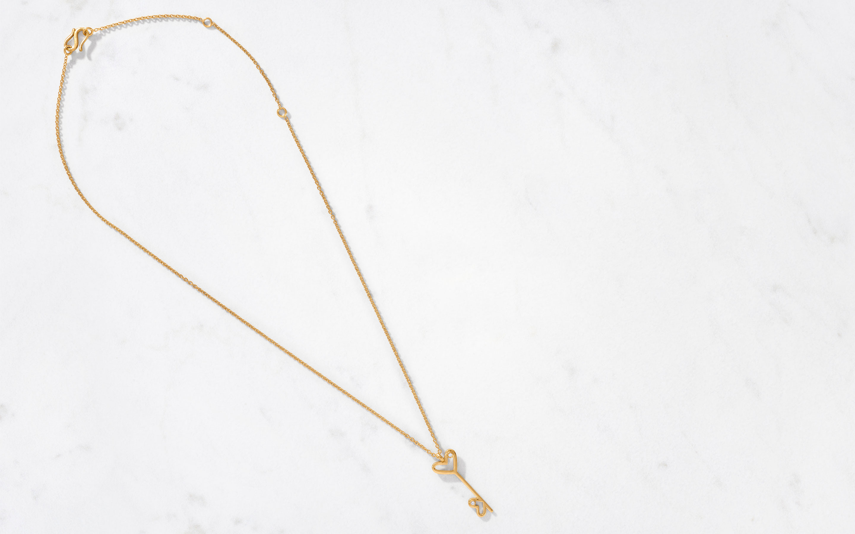 22 karat gold necklace with modern pendant in double heart key design