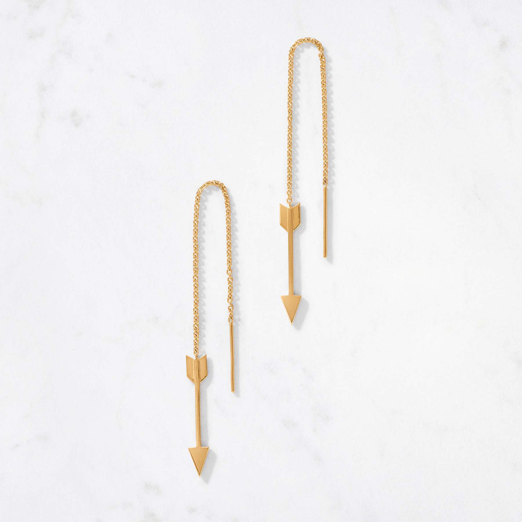 Handcrafted from 22 karat gold with a gold weight of approximately 3.8 grams, our Golden Arrow Threader Earrings shoot delicately through air and your ears on a fine, ultra light chain for a cool, sharp look.